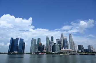 A general view shows the financial business district in Singapore on May 26, 2020. - Singapore's economy, a bellwether for global trade, could shrink by as much as 7.0 percent this year, the worst since independence, as the coronavirus pandemic throttles demand, the government said on May 26. (Photo by Roslan RAHMAN / AFP)