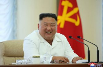 """In this picture taken on June 7, 2020 and released from North Korea's official Korean Central News Agency (KCNA) on June 8, 2020 North Korean leader Kim Jong Un smiles as he attends the 13th Political Bureau meeting of the 7th Central Committee of the Workers' Party of Korea (WPK) in an undisclosed location in North Korea. (Photo by STR / KCNA VIA KNS / AFP) / South Korea OUT / ---EDITORS NOTE--- RESTRICTED TO EDITORIAL USE - MANDATORY CREDIT """"AFP PHOTO/KCNA VIA KNS"""" - NO MARKETING NO ADVERTISING CAMPAIGNS - DISTRIBUTED AS A SERVICE TO CLIENTS / THIS PICTURE WAS MADE AVAILABLE BY A THIRD PARTY. AFP CAN NOT INDEPENDENTLY VERIFY THE AUTHENTICITY, LOCATION, DATE AND CONTENT OF THIS IMAGE --- /"""