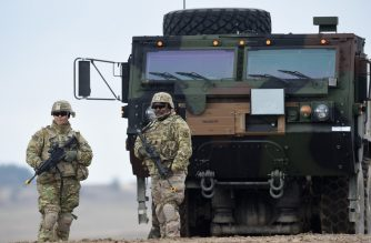 "(FILES) In this file photo taken on March 04, 2020, US soldiers patrol prior to an artillery live fire event by the US Army Europe's 41st Field Artillery Brigade at the military training area in Grafenwoehr, Germany. - President Donald Trump on June 15, 2020 said he is cutting the number of US troops in Germany by half because Berlin is ""delinquent"" in its contributions to NATO and treats the US ""badly"" on trade. Trump told reporters there are 52,000 US soldiers stationed in Germany. (Photo by Christof STACHE / AFP)"