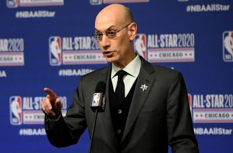 (FILES) In this file photo taken on February 15, 2020 NBA Commissioner Adam Silver speaks to the media during a press conference at the United Center in Chicago, Illinois. - The NBA says that players who decline to play in the restarted season in Florida next month must let their clubs know by June 24, 2020 and will face having their pay docked by up to 14 games. ESPN.com reported that the NBA Players Association informed its members on June 16, 2020 that they have until June 24 to make a decision whether to take part in the games at the Walt Disney World resort in Orlando, Florida. (Photo by Stacy Revere / GETTY IMAGES NORTH AMERICA / AFP)