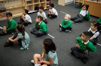 Reception pupils are taught in a class with reduced numbers and social distancing measures in place, in order to minimise the risk of passing Coronavirus, at Greenacres Primary Academy in Oldham, northern England on June 18, 2020 as primary schools to recommence education for Reception, Years 1 and Year 6 classes, alongside priority groups. (Photo by OLI SCARFF / AFP)