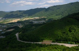 A photo taken on June 16, 2020 shows tank traps on a road leading to the 'Punchbowl', near the Demilitarized Zone separating north and south Korea, in the Haean area of Yanggu. - From North Korean party headquarters to holiday homes to cemeteries, 70 years after the Korean War began its legacies line the Demilitarized Zone that marks where the fighting came to a standstill. (Photo by Ed JONES / AFP) / To go with SKorea-NKorea-war-anniversary-legacies, by Hwang Sunghee