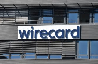 """The company logo is seen at the headquarters of German payments provider Wirecard in Aschheim near Munich, southern Germany, on June 24, 2020. - In what could be one of the biggest financial frauds of recent years, German payments provider Wirecard admitted 1.9 billion euros that auditors say are missing from its accounts likely """"do not exist"""". (Photo by Christof STACHE / AFP)"""