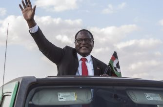 (FILES) In this file photo taken on June 20, 2020, Malawi's main opposition Malawi Congress Party, MCP, Leader Lazarus Chakwera who is leading the Tonse Alliance in the Presidential elections due on June 23, arrives at Mtandire locations in the suburb of the capital Lilongwe to hold his final rally. - Chakwera on June 27, 2020 was declared winner of this week's presidential election re-run with 58.75 percent of the vote according to the electoral commission said, AFP reports. (Photo by AMOS GUMULIRA / AFP)