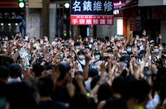 Protesters chant slogans and gesture during a rally against a new national security law in Hong Kong on July 1, 2020, on the 23rd anniversary of the city's handover from Britain to China. - Hong Kong police arrested more than 300 people on July 1 -- including nine under China's new national security law -- as thousands defied a ban on protests on the anniversary of the city's handover to China. (Photo by Anthony WALLACE / AFP)