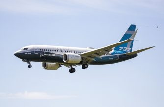 (FILES) In this file photo taken on June 29, 2020 A Boeing 737 MAX jet comes in for a landing following a Federal Aviation Administration (FAA) test flight at Boeing Field in Seattle, Washington. - Air safety regulators successfully completed three days of flight tests on the Boeing 737 MAX, a key step in recertifying the plane, US officials said July 1. (Photo by Jason Redmond / AFP)