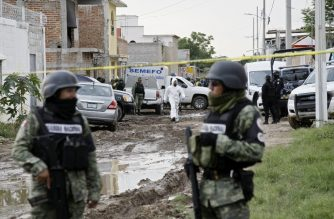 Members of the National Guard remain near the crime scene where 24 people were killed in Irapuato, Guanajuato state, Mexico, on July 1, 2020. - An armed attack at a drug rehabilitation center in Irapuato, a town in the central Mexican state of Guanajuato, left at least 24 dead and seven wounded on Wednesday, local authorities reported. (Photo by MARIO ARMAS / AFP)