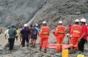 "This handout from the Myanmar Fire Services Department taken and released on July 2, 2020 shows rescuers attempting to locate survivors after a landslide at a jade mine in Hpakant, Kachin state. - The bodies of at least 50 jade miners were pulled from the mud on July 2 after a landslide in northern Myanmar, fire services said, as monsoon rains worsen already deadly conditions. (Photo by Handout / MYANMAR FIRE SERVICES DEPARTMENT / AFP) / -----EDITORS NOTE --- RESTRICTED TO EDITORIAL USE - MANDATORY CREDIT ""AFP PHOTO / MYANMAR FIRE SERVICES DEPARTMENT "" - NO MARKETING - NO ADVERTISING CAMPAIGNS - DISTRIBUTED AS A SERVICE TO CLIENTS"