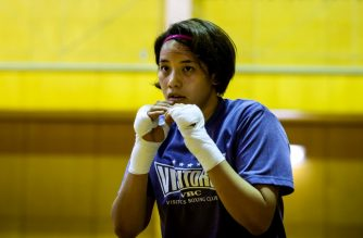 This photo taken on June 4, 2020 shows Japanese boxer and nurse Arisa Tsubata warming up during her training at a hospital's gymnasium in Saitama. - Olympic boxing hopeful Arisa Tsubata is used to taking a barrage of blows in the ring but she faces her toughest opponent as a nurse every day: coronavirus. (Photo by Behrouz MEHRI / AFP) / TO GO WITH AFP STORY Oly-2020-2021-Box-JPN-Japan-virus-health by Harumi Ozawa