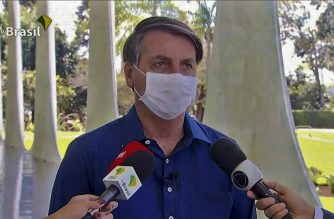 "Screen grab of TV Brasil showing Brazilian President Jair Bolsonaro speaking at Planalto Palace in Brasilia on July 7, 2020. - Brazil President Jair Bolsonaro announced on Tuesday he had tested positive for the coronavirus but said he was feeling ""perfectly well"" and had only mild symptoms. (Photo by - / TV BRASIL / AFP)"
