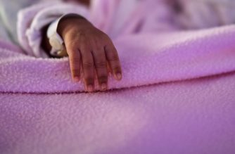 View of the hand of Zoe, a newborn quadruplet, at the Ramon Sarda Maternity Hospital in Buenos Aires, on July 7, 2020, amid the new coronavirus pandemic. - Adriana Beramendi gave birth to the babies about 1,500 km away from her Bolivian husband, who is not allowed to enter Argentina since the borders remain closed to prevent the spread of the new coronavirus. (Photo by RONALDO SCHEMIDT / AFP)