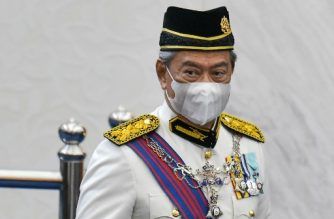 "(FILES) In this file handout photo from Malaysia's Department of Information taken on May 18, 2020 Malaysia's Prime Minister Muhyiddin Yassin wearing a face mask during the opening ceremony of the third term of the 14th parliamentary session in Kuala Lumpur. - Malaysia's prime minister narrowly won a vote to remove the parliament speaker during a rowdy session of the legislature July 13, a key test of support for the embattled leader. (Photo by Nazri RAPAAI / Malaysia's Department of Information / AFP) / -----EDITORS NOTE --- RESTRICTED TO EDITORIAL USE - MANDATORY CREDIT ""AFP PHOTO / MALAYSIA'S DEPARTMENT OF INFORMATION/  NAZRI RAPAAI "" - NO MARKETING - NO ADVERTISING CAMPAIGNS - DISTRIBUTED AS A SERVICE TO CLIENTS"