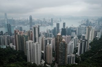 (FILES) In this file photo taken on on April 7, 2020, a general view, taken from the tourist attraction Victoria Peak, shows the skylines of Kowloon (back) and Hong Kong Island (foreground). - China's new security law has sent a chill through Hong Kong's schools and universities with many teachers fearful the city's reputation for academic freedom and excellence is now at risk. (Photo by ANTHONY WALLACE / AFP) / TO GO WITH AFP STORY HONG KONG-CHINA-POLITICS-EDUCATION,FOCUS BY JEROME TAYLOR AND SU XINQI