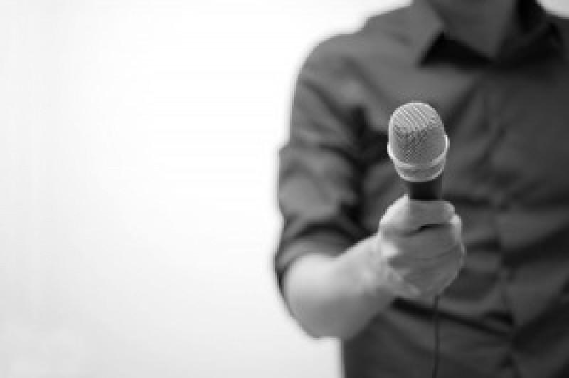 man-holding-microphone