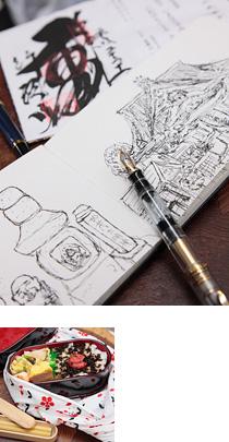 万年筆とノート、手作り弁当の写真、