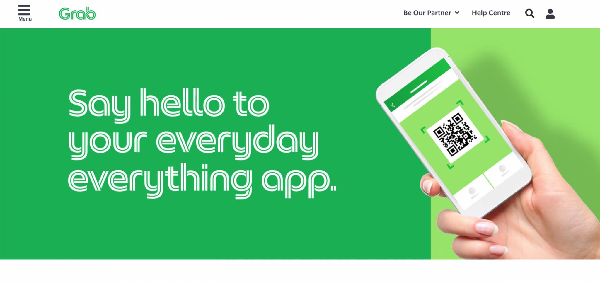實用App:綠色的官網底配上一隻手拿著手機開啟軟體畫面英文字