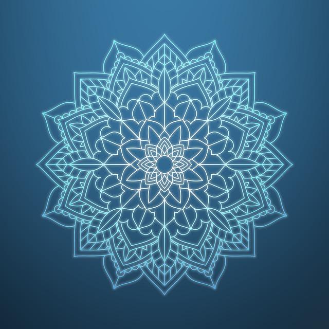 青い背景にマンダラ模様が描かれている