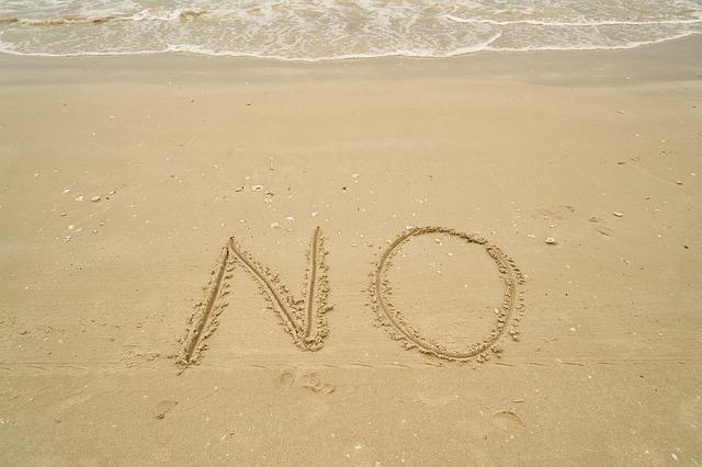 砂に書いたNO