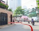 メゾン・マンドー Nguyen U Di (グエンウーイー)通りに出ます。進んでいくと、左手にレンガ造りの壁が見えてきます。