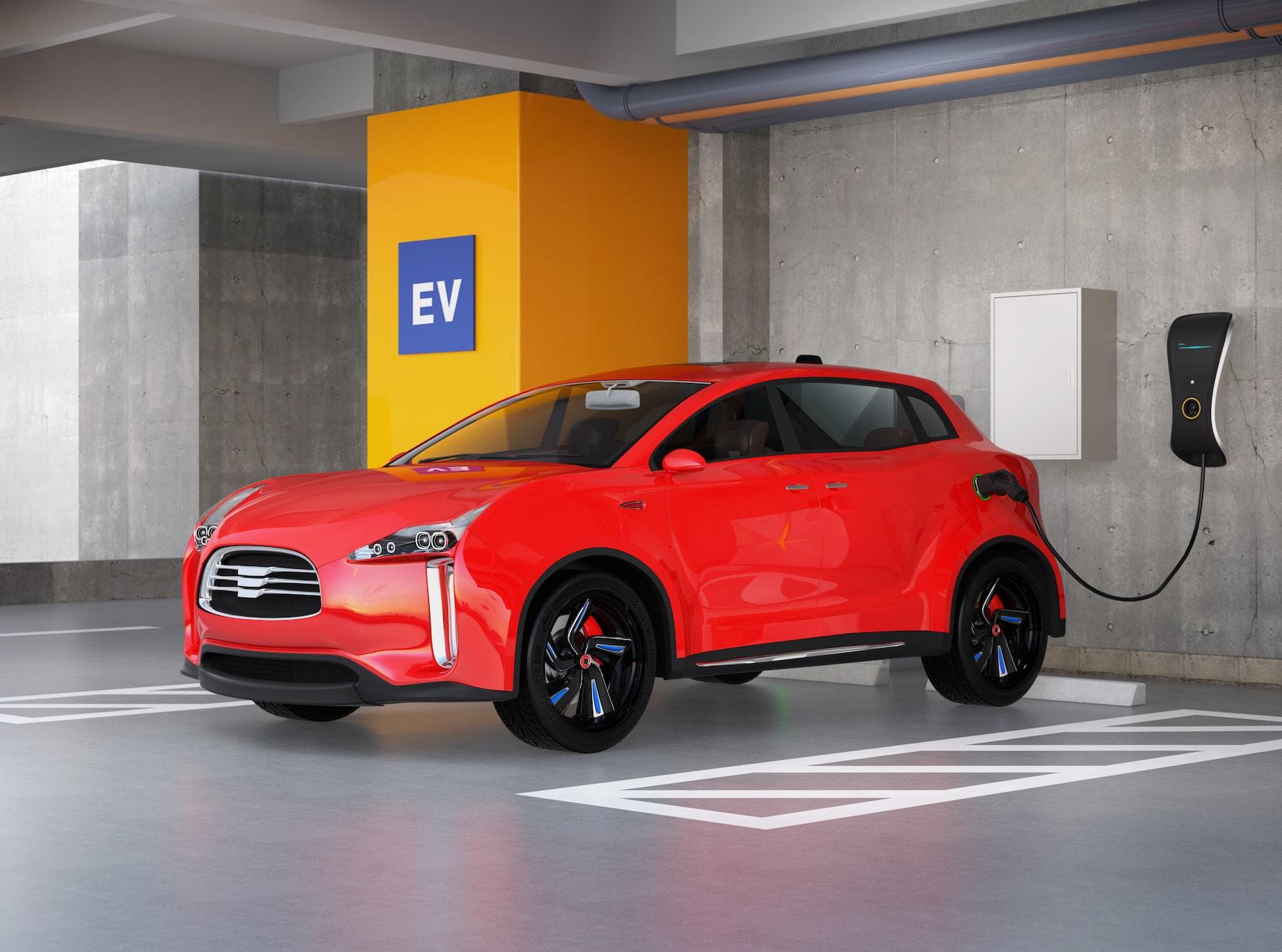 充電される赤い電気自動車