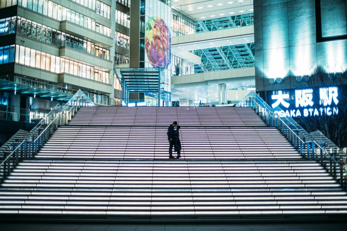 On the stairs of Osaka Station — Photo by GQ wedding photojournalism