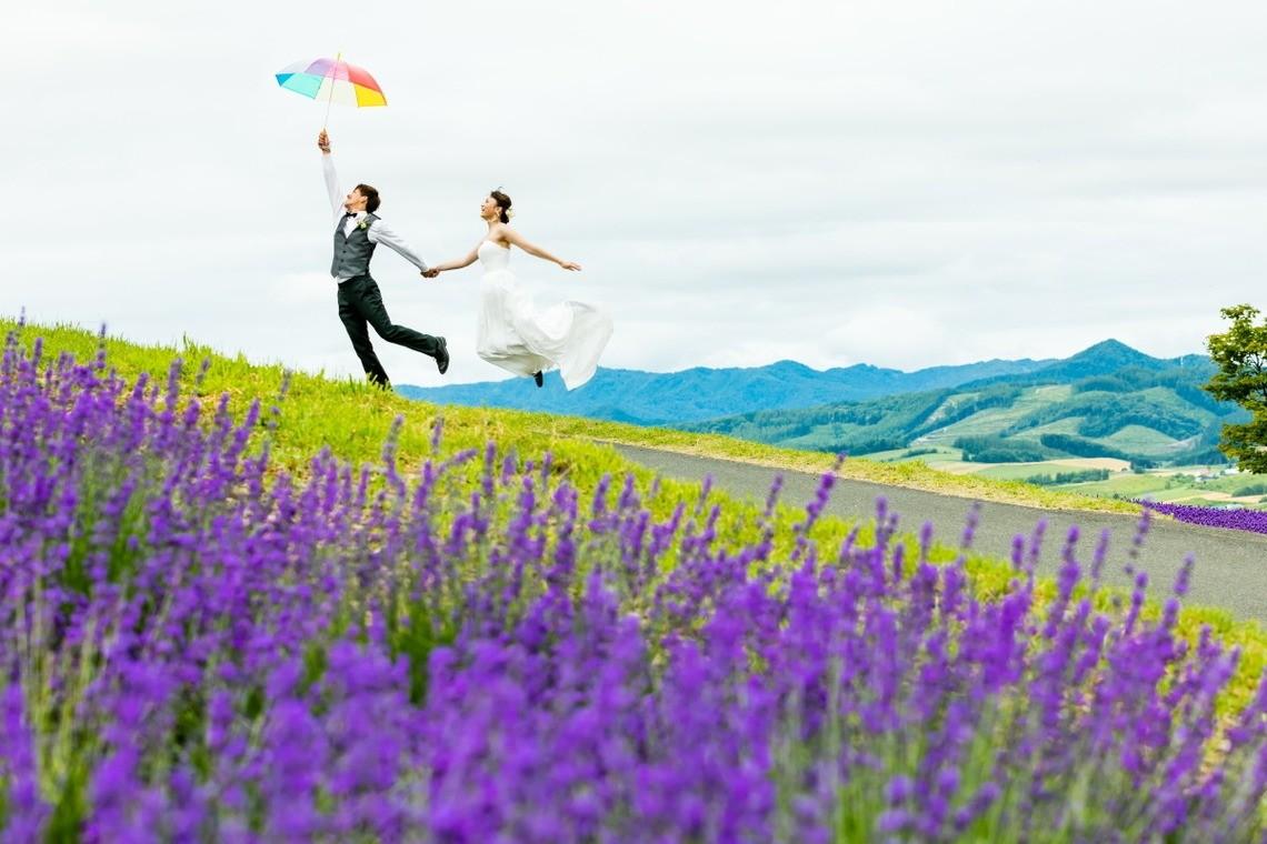 Couple in Furano, Hokkaido floating away — Photo by Lykke photo style