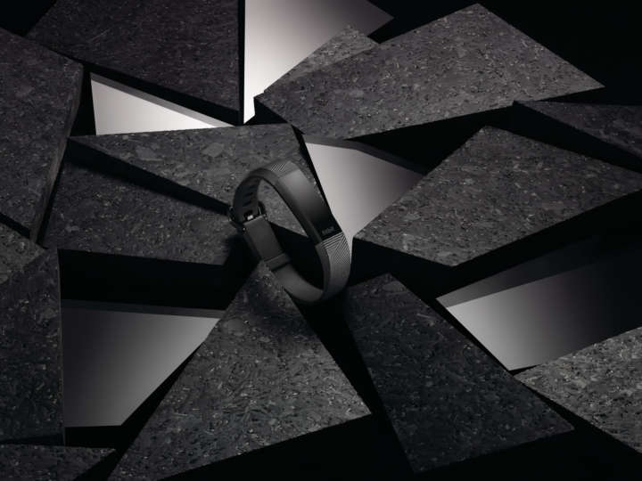 Fancy still photography of Alta HR in special edition gunmetal on a black background of mixed materials.