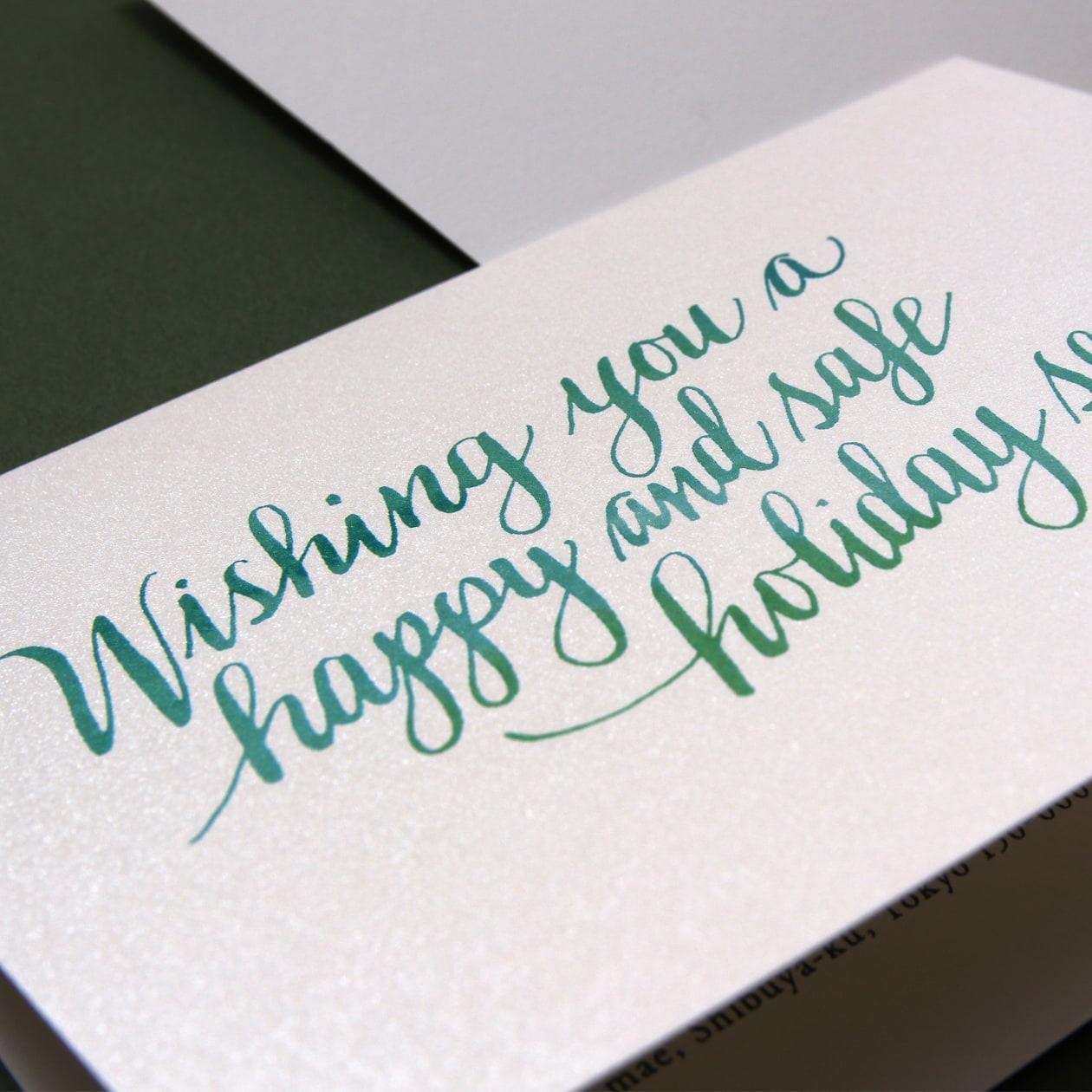 カリグラフィーが印象的なクリスマスカード
