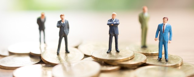 Miniature people standing on coin,Business concept