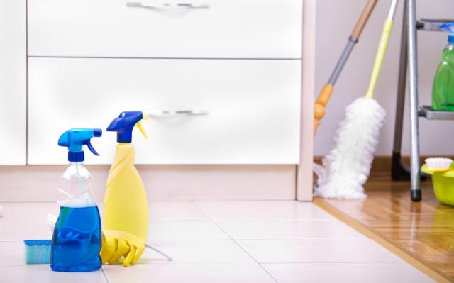 Two spray bottles on kitchen floor
