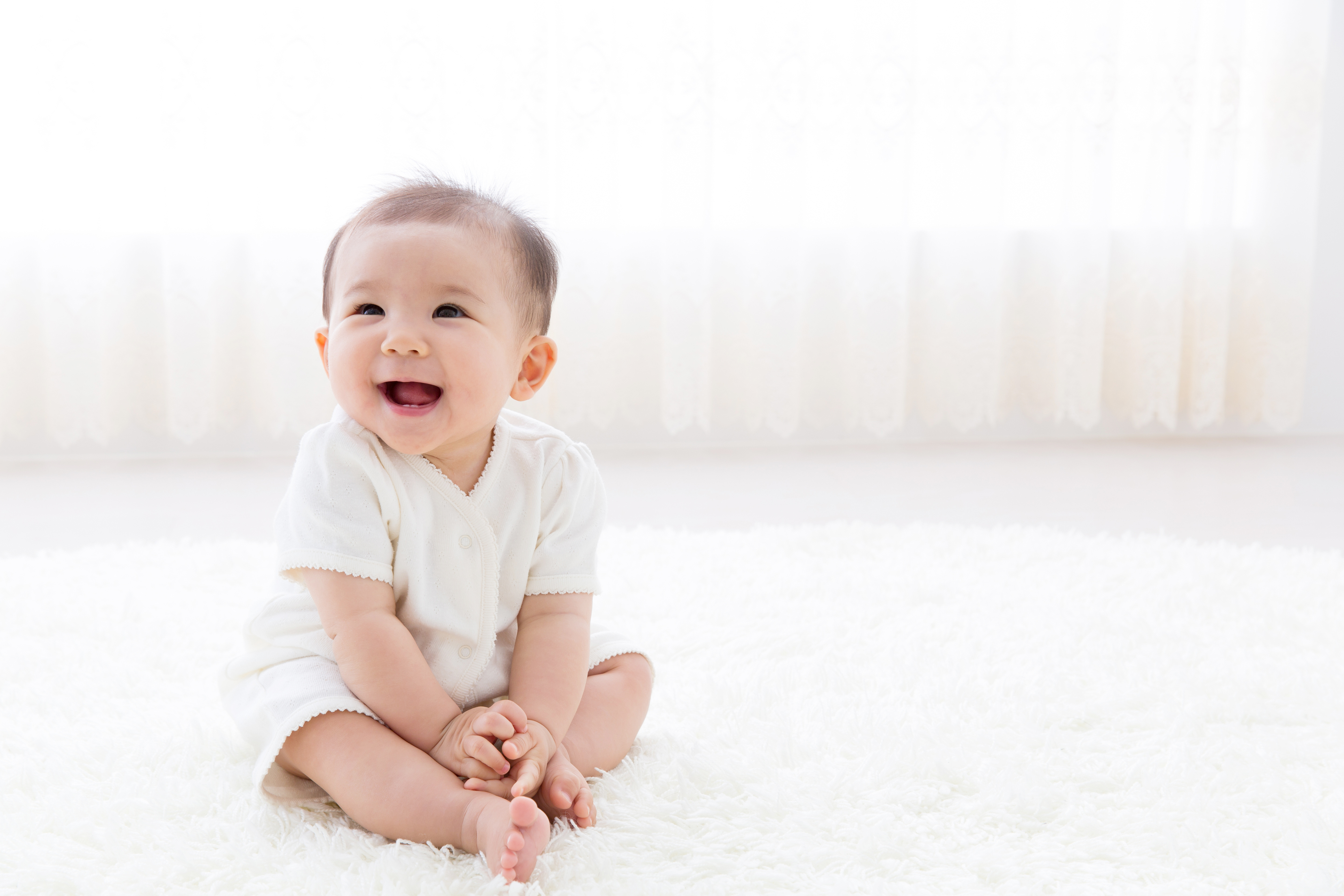 portrait of asian baby in living room