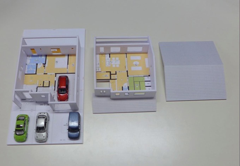 建築システム(狭小住宅専門店)【収納力、夫婦で暮らす、ガレージ】計画段階からイメージを膨らませるために、模型を使って暮らし方や外観デザインをイメージ