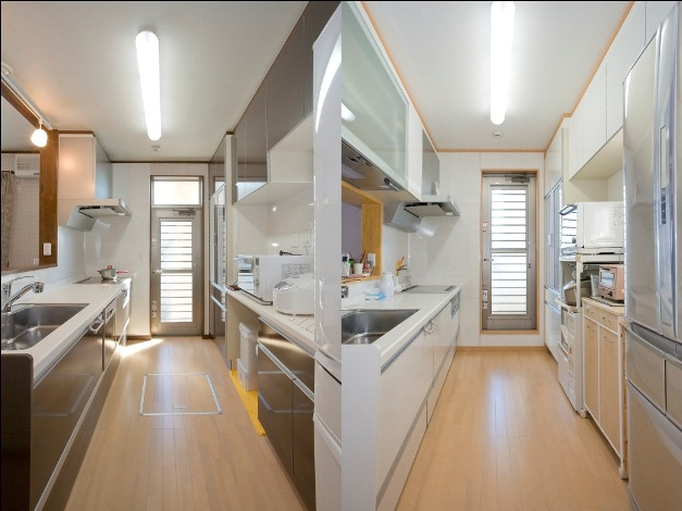 石上建設【子育て、収納力、二世帯住宅】1Fの親世帯はリビングに合わせたシックなカラーのキッチン。背面の大型収納でキッチン周りはいつもスッキリ。2Fの子世帯は白を基調にした明るいキッチンに。シンク上部の吊戸棚は電動で昇降するので小柄な奥様にもとても使いやすい。同じ対面式のキッチンだが、カラーや収納の配置など、それぞれの世帯の希望が形になった。