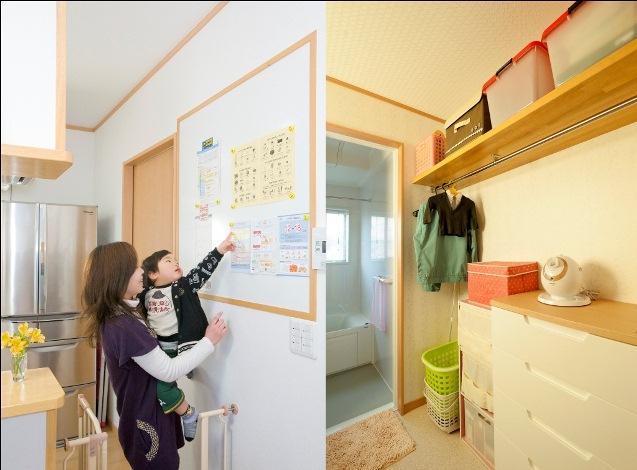 石上建設【子育て、収納力、二世帯住宅】2Fキッチン近くの壁にホワイトボードが取り付けられており、幼稚園のお便りなどを貼り付けたり、メモボードとしても利用できる。冷蔵庫まわりはこれでスッキリだ。その先にある洗面脱衣室は奥さんが一番こだわった場所。ご主人の仕事着や着替えなどが収納でき、お子さんを起こさずに朝の支度がすべて出来るようになっている。