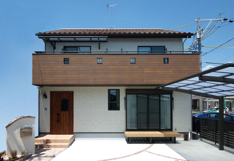 明和住宅【子育て、収納力、間取り】南欧風の屋根瓦からプランづくりが再スタート。木調のバルコニーや玄関へのアプローチもイメージ通りに