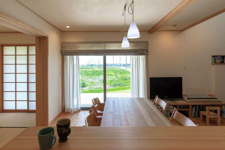 ナルセノイエ【子育て、和風、自然素材】一番のお気に入りはキッチンからの眺め。開放的な間取りで、常に家族の存在を感じられるのがいい