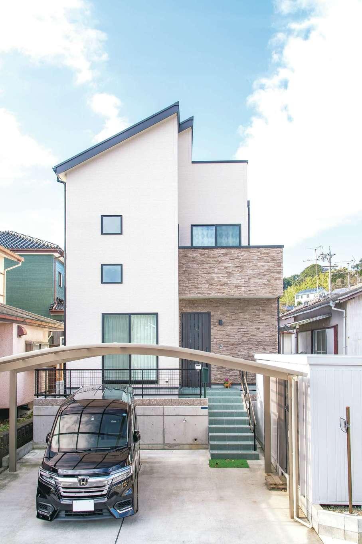 三和建設【収納力、屋上バルコニー、スキップフロア】高さ制限ギリギリに設計されたS邸。表情豊かな石目調タイルが外観のアクセントとなり、洗練された印象に