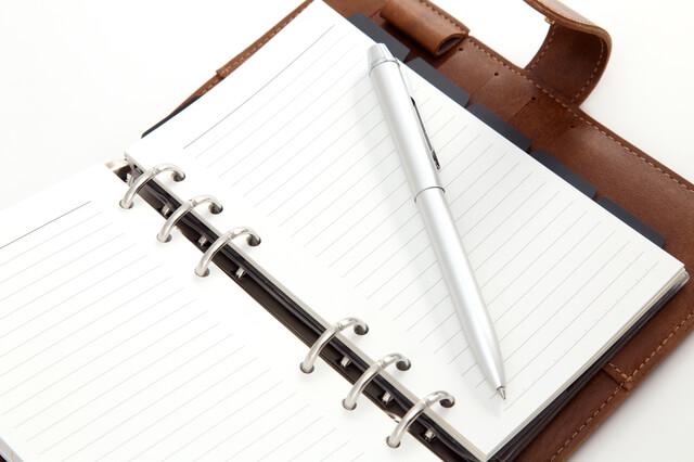 開かれた皮の手帳,手作り,手帳,