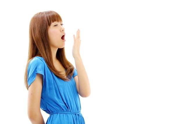 あくびをする女性,PMS,妊娠,