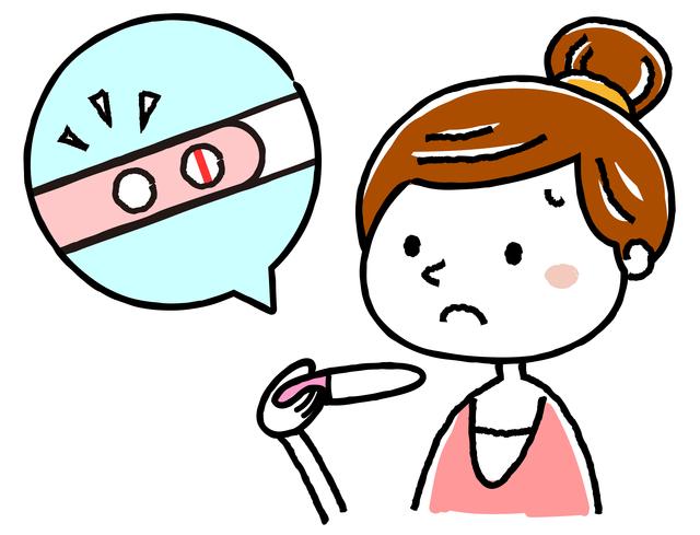 妊娠検査薬を見る女性,妊娠,高温期,