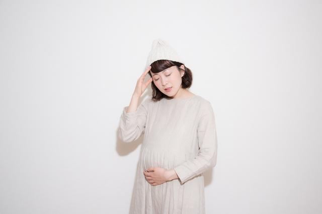 体調不良の妊婦さんイメージ,妊娠中,病気,