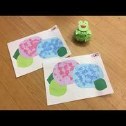 【6月 雨の日制作】1、2歳児画用紙、絵の具、スポンジ、輪ゴム、ペットボトルのキャップ花紙、ビニール袋、丸シール輪ゴムを十字につけるとスポンジが紫陽花の花びらの形に子どもたちはカエルの目と口を貼り付け♪花紙をくしゃくしゃにして袋につめとても楽しそうでした