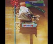 【こいのぼり】・2歳児・吹き流し:シール貼り・まごい:紙袋になぐり描き・ひごい:折り染め 牛乳パック