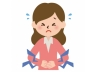 医療-お腹が痛む女性