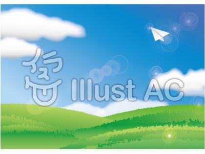 紙飛行機のある高原と青空の風景