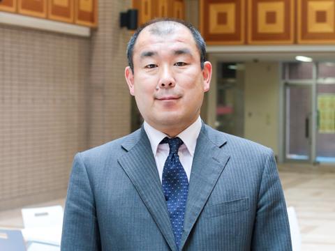 学校説明会で新しい教育システムの説明を担当された鈴木仁先生