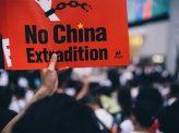 中国に及び腰の大手紙社説