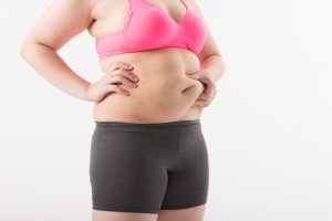 028 ダイエット diet ぽっちゃりの女性のお腹 お腹を揉んでいる 痩せる