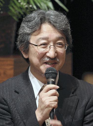 成田先生紙面写真.jpg