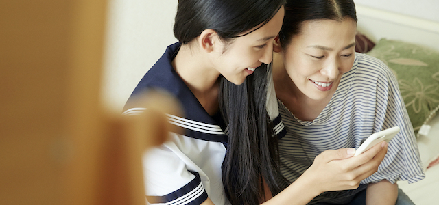 Mother and daughter looking at a smartphone